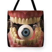 Eye Held By Teeth Tote Bag by Garry Gay