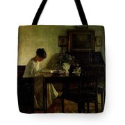 Girl Reading In An Interior  Tote Bag by Carl Holsoe