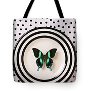 Green and black butterfly on plate Tote Bag by Garry Gay