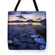 Ice Flakes Drifting Against The Sunset Tote Bag by Arild Heitmann