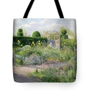 Irises In The Herb Garden Tote Bag by Timothy Easton