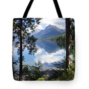 Lake Mcdlonald Through The Trees Glacier National Park Tote Bag by Marty Koch