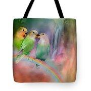 Love On A Rainbow Tote Bag by Carol Cavalaris