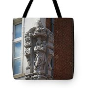 Madonna and Child Statue on the Corner of a House in Bruges Tote Bag by Louise Heusinkveld