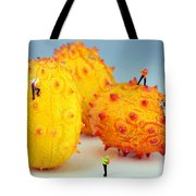 Mountain Climber On Mangosteens Tote Bag by Paul Ge