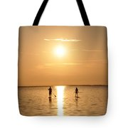 Paddle Boarding Out Of The Sunset Tote Bag by Bill Cannon