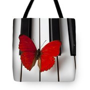 Red Butterfly On Piano Keys Tote Bag by Garry Gay