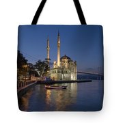 The Ortakoy Mosque And Bosphorus Bridge At Dusk Tote Bag by Ayhan Altun