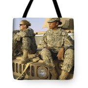 Two U.s. Army Soldiers Relax Prior Tote Bag by Stocktrek Images