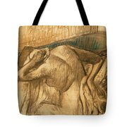Woman At Her Toilet Tote Bag by Edgar Degas
