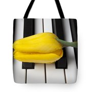 Yellow Tulip On Piano Keys Tote Bag by Garry Gay