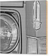 Cadillac Headlight Emblem Wood Print by Jill Reger