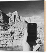 man taking photos with smartphone during boat ride along the colorado river in the grand canyon Ariz Wood Print by Joe Fox