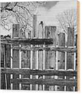 old patched up wooden fence using old bits of wood in snow Forget Saskatchewan Canada Wood Print by Joe Fox