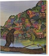 Raven And The Village  Wood Print by Carolyn Doe