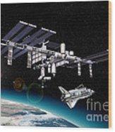 Space Station In Orbit Around Earth Wood Print by Leonello Calvetti