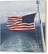American Flag Blowing In The Wind At Sea Wood Print by Jessica Foster
