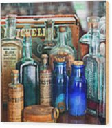 Apothecary - Remedies For The Fits Wood Print by Mike Savad