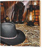 Black Cowboy Hat In An Old Barn Wood Print by Olivier Le Queinec
