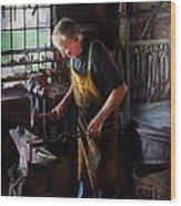 Blacksmith - Starting With A Bang  Wood Print by Mike Savad