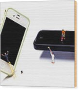 Cleaning The Iphones Little People Big Worlds Wood Print by Paul Ge