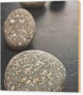 Curving Line Of Speckled Grey Pebbles On Dark Background Wood Print by Colin and Linda McKie