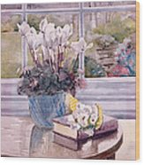 Flowers And Book On Table Wood Print by Julia Rowntree
