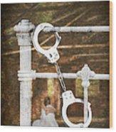 Handcuffs On Bed Wood Print by Amanda Elwell
