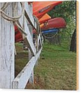 Kayaks On A Fence Wood Print by Michael Mooney