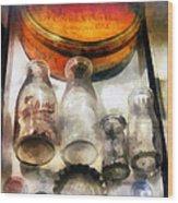 Milk Bottles In Dairy Case Wood Print by Susan Savad
