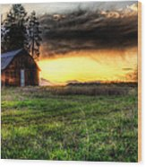 Mountain Sun Behind Barn Wood Print by Derek Haller