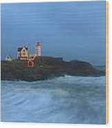 Nubble Lighthouse High Surf And Holiday Lights Wood Print by John Burk