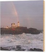 Nubble Lighthouse Rainbow And Surf At Sunset Wood Print by John Burk