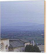 Panoramic View Of Assisi At Night Wood Print by Susan Schmitz