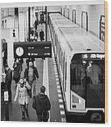 passengers on ubahn train platform as train leaves Friedrichstrasse u-bahn station Berlin Germany Wood Print by Joe Fox