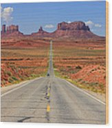 Scenic Road Into Monument Valley Wood Print by Johnny Adolphson
