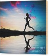 Silhouette Of Woman Running At Sunset Wood Print by Michal Bednarek