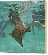Snorkellers Holding A Four Legs Starfish Wood Print by Sami Sarkis