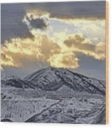 Stormy Sunset Over Snow Capped Mountains Wood Print by Tracie Kaska