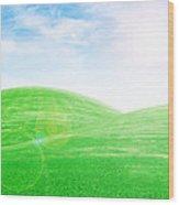 Sunrise Over Green Grass Hills Wood Print by Thanapol Kuptanisakorn