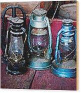 Three Kerosene Lamps Wood Print by Susan Savad
