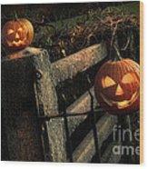 Two Halloween Pumpkins Sitting On Fence Wood Print by Sandra Cunningham