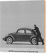 Vw Beetle Advert 1962 - And If You Run Out Of Gas It's Easy To Push Wood Print by Georgia Fowler