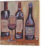 Wine Bottle Trio Wood Print by Donna Tuten