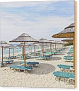 Beach Umbrellas On Sandy Seashore Wood Print by Elena Elisseeva