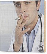 Doctor Smoking Wood Print by Adam Gault