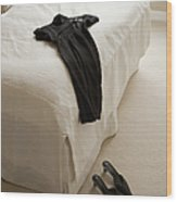 Dress Lying On Bed Wood Print by Shannon Fagan
