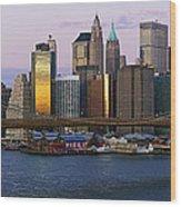 Lower Manhattan Skyline And Brooklyn Bridge At Dawn Wood Print by Jeremy Woodhouse