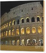Coliseum Illuminated At Night. Rome Wood Print by Bernard Jaubert