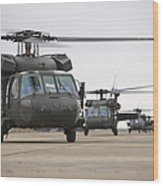 Uh-60 Black Hawks Taxis Wood Print by Terry Moore